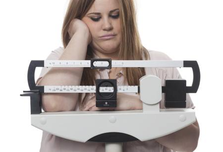 Overweight woman with depressed expression