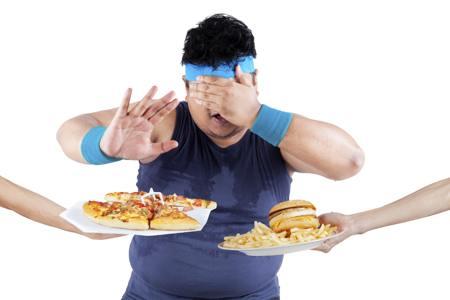 Fat man rejecting junk foods